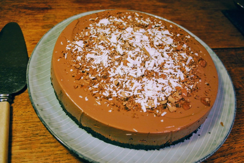 A vegan chocolate tart decorated with chocolate shavings